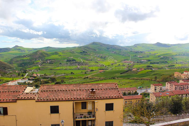 Beautiful view of green Sicilian countryside landscape photographed from small village Gangi. Nature and cities in Italy. Houses royalty free stock photos
