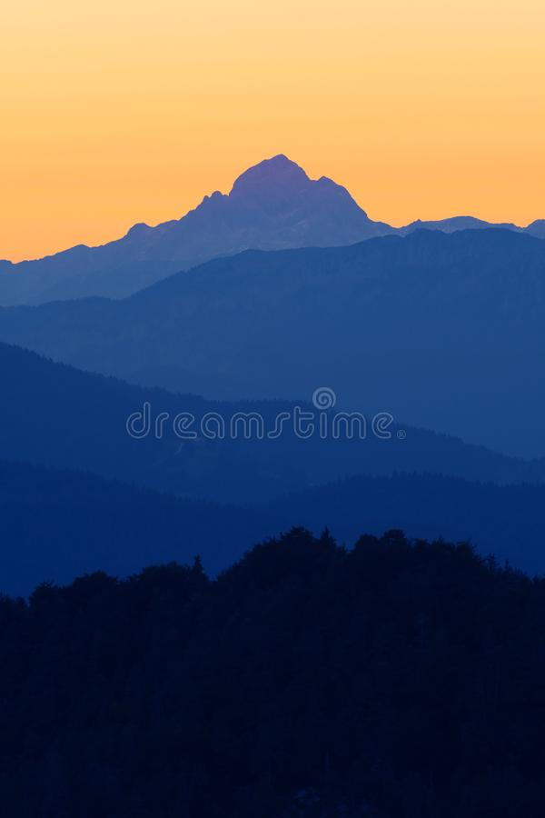 Beautiful view of highest peak in Slovenian Alps after sunset stock photos
