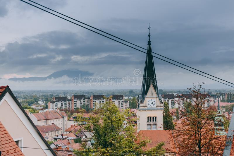Beautiful view of the historic center of the European city in cloudy weather. Beautiful view of the historic center of the European city and the mountains on the royalty free stock image