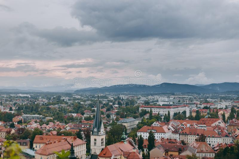 Beautiful view of the historic center of the European city in cloudy weather. Beautiful view of the historic center of the European city and the mountains on the royalty free stock photography