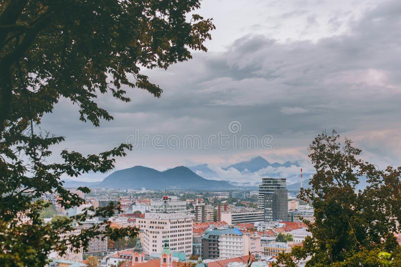 Beautiful view of the historic center of the European city in cloudy weather. Beautiful view of the historic center of the European city and the mountains on the royalty free stock photo