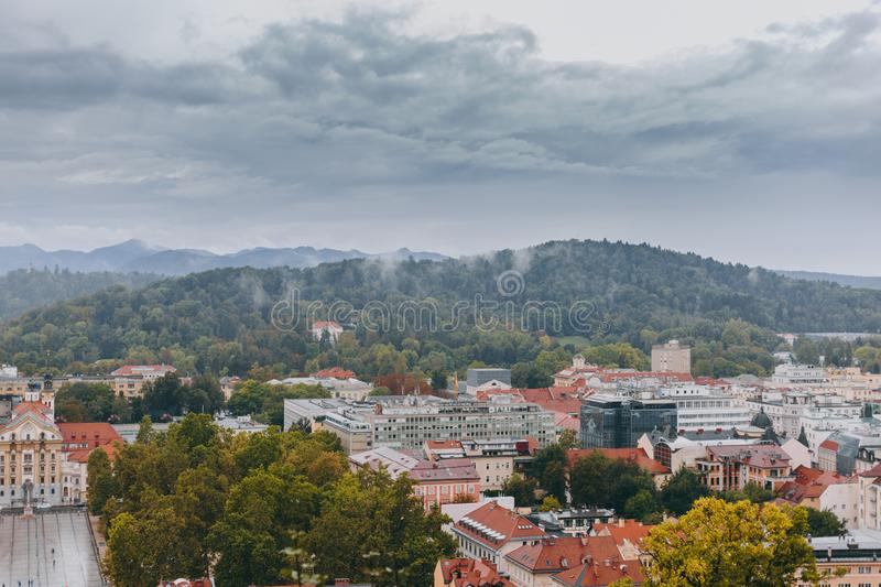 Beautiful view of the historic center of the European city in cloudy weather. Beautiful view of the historic center of the European city and the mountains on the stock photography