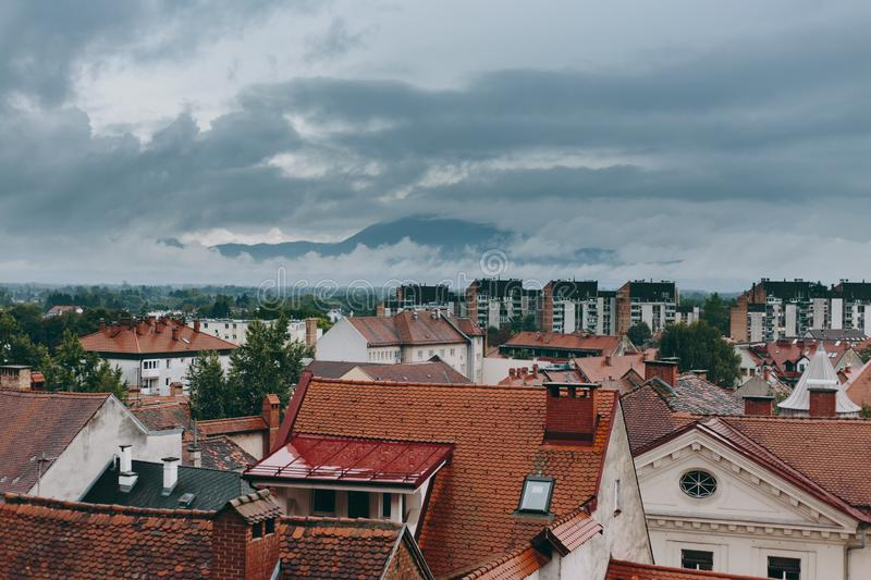 Beautiful view of the historic center of the European city in cloudy weather. Beautiful view of the historic center of the European city and the mountains on the stock photos