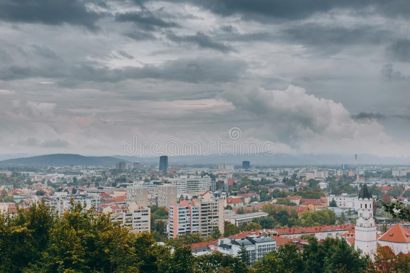 Beautiful view of the historic center of the European city in cloudy weather. Beautiful view of the historic center of the European city and the mountains on the stock image