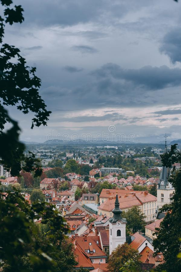 Beautiful view of the historic center of the European city in cloudy weather. Beautiful view of the historic center of the European city and the mountains on the royalty free stock photos