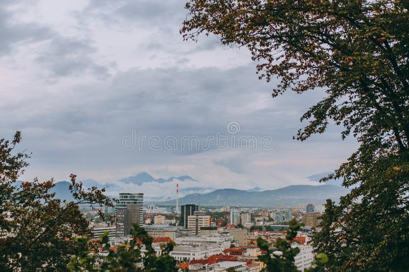 Beautiful view of the historic center of the European city in cloudy weather. Beautiful view of the historic center of the European city and the mountains on the stock images