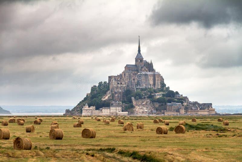 Cloudscape field at Le Mont Saint-Michel stock images