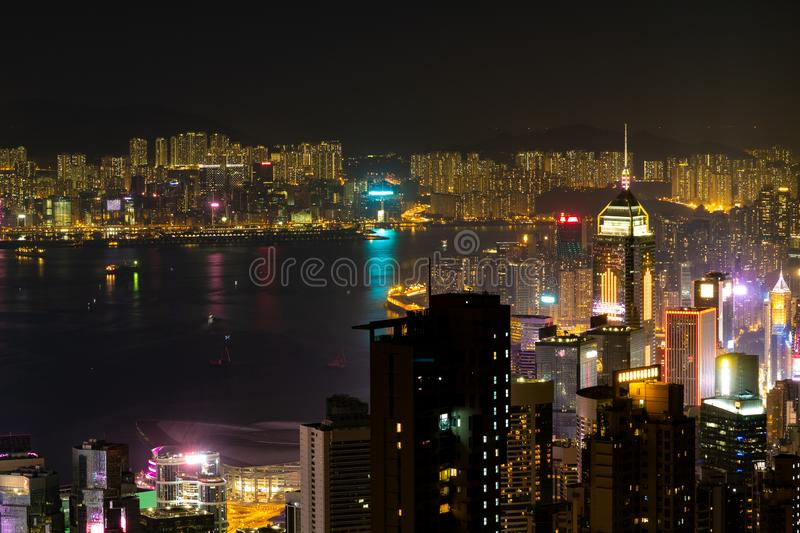 Beautiful view of the Hong Kong Skyline at night. Colorful Victoria Harbor view and the Business and nightlife district in Central royalty free stock photography