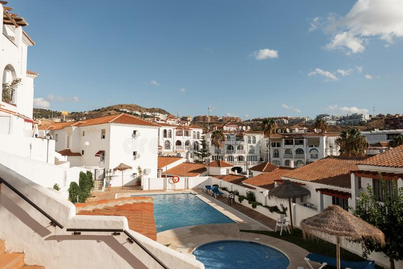 Beautiful view from the hotel to the area with the pool on the old white city and the mountains. Mijas. South sunny Spain. royalty free stock images