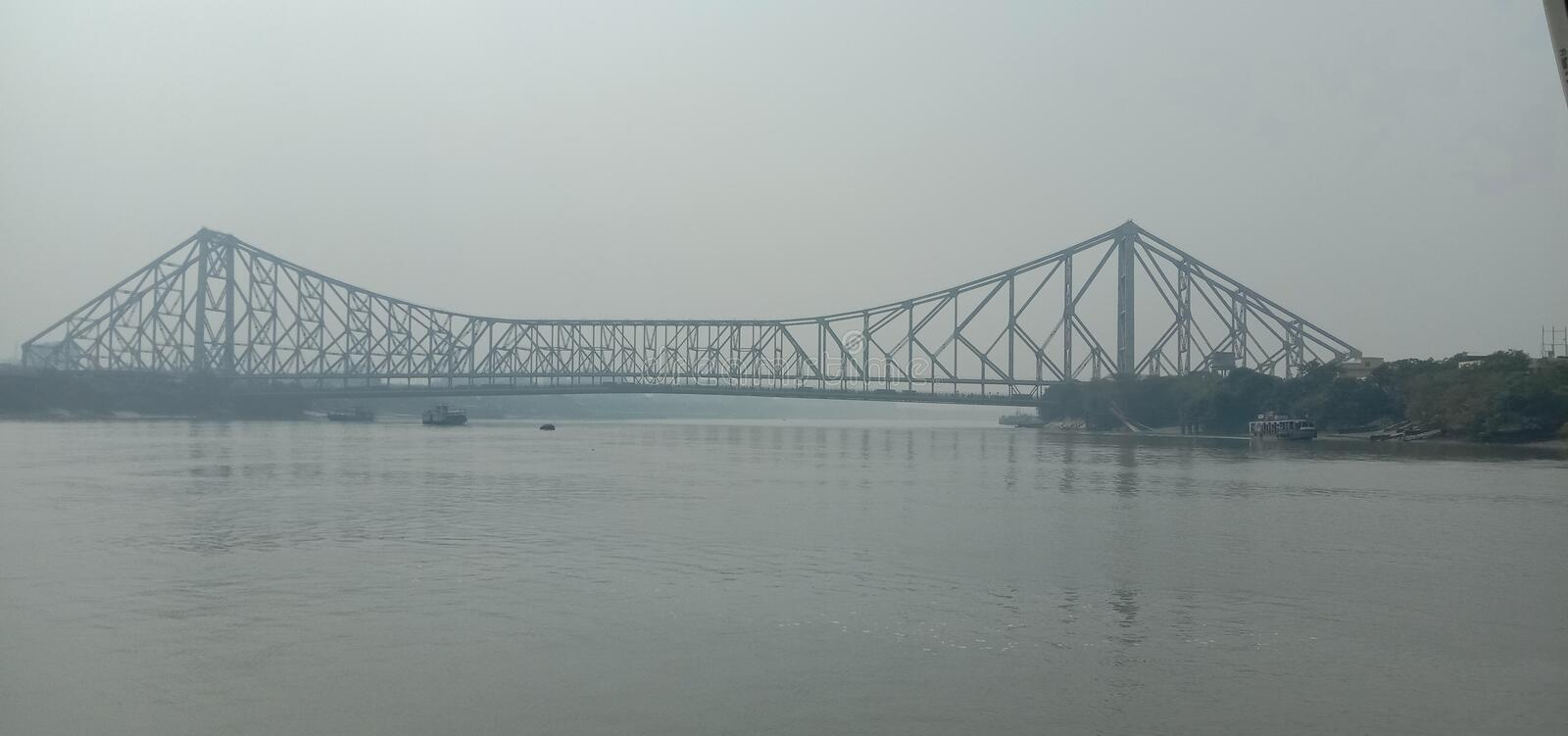 A beautiful view of Howrah Bridge from the middle of river hooghly e between ahiritola to Howrah customer journey W B India. A beautiful view of Howrah Bridge royalty free stock photography