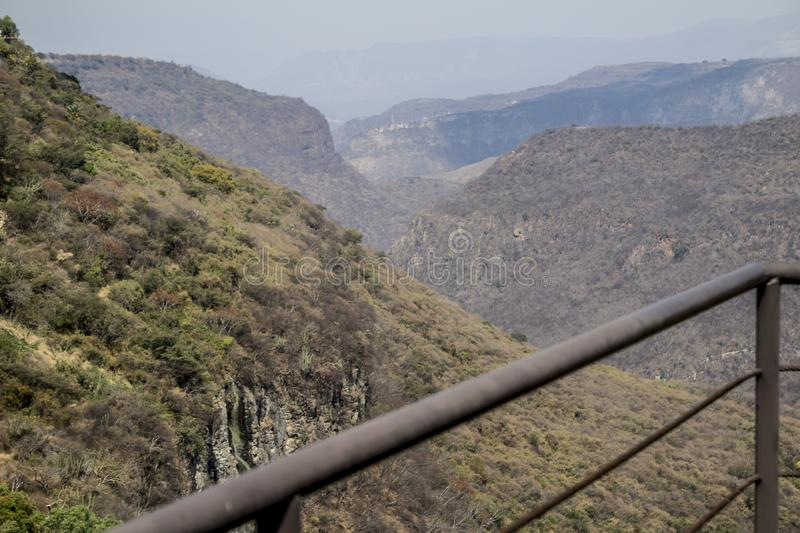 Beautiful view of Huentitan canyon on a wonderful day. Beautiful view of Huentitan on a wonderful day with a gray sky in Guadalajara Jalisco Mexico,copy space stock photos