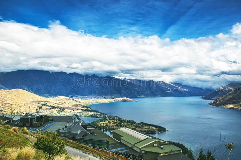 Beautiful view of lake Wakatipu in Queenstown from the hill on a cloudy weather. New Zealand royalty free stock image
