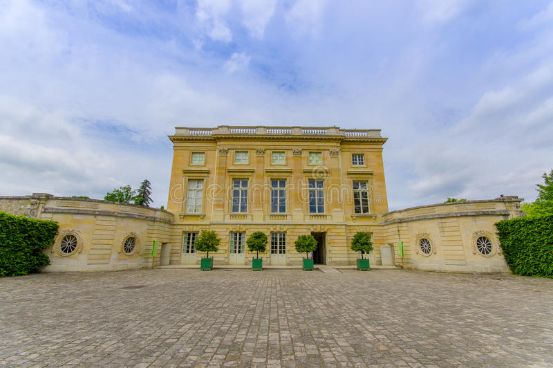 Beautiful view of Le Petit Trianon facade. PARIS, FRANCE - JUNE 1, 2015: Beautiful view of Le Petit Trianon facade in Versailles royalty free stock images
