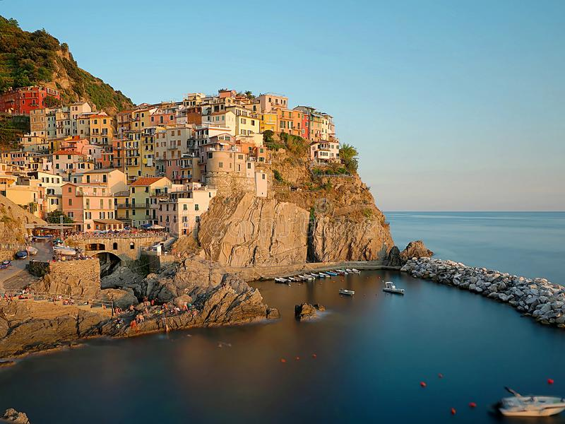 Beautiful view of Manarola at sunset, with water between the rocks in the lower part forming a blue heart royalty free stock images
