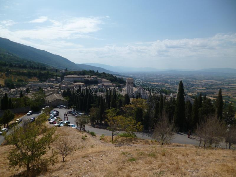 Beautiful view of the medieval town of Assisi from the hill. Italy, August 2012 stock photography