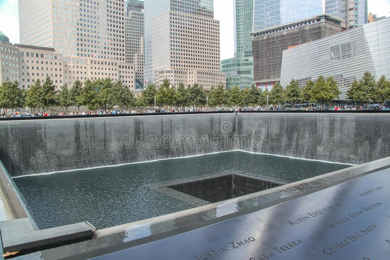 Beautiful view of 9/11 Memorial's twin reflecting pools. Largest manmade waterfalls. Historical places concept. royalty free stock photography