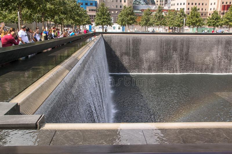 Beautiful view of 9/11 Memorial's twin reflecting pools. Largest manmade waterfalls. Historical places concept.  USA. New York. royalty free stock photo