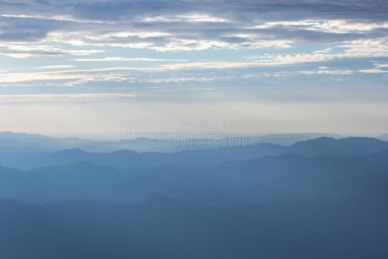 Beautiful view of the morning fog filling the valleys of smooth hills. Natural background and texture stock photography