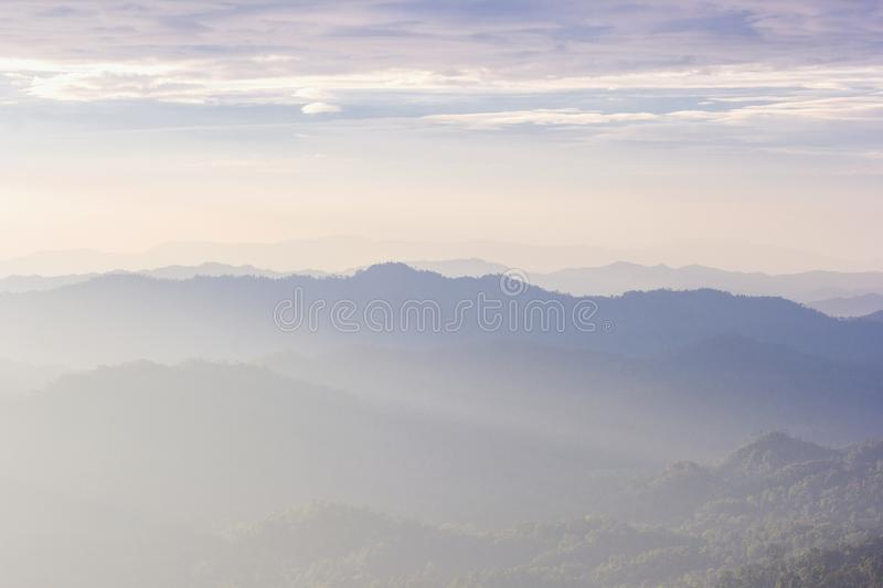 Beautiful view of the morning fog filling the valleys of smooth hills. Kanchanaburi, Thailand royalty free stock photo