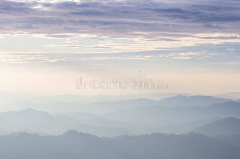 Beautiful view of the morning fog filling the valleys of smooth hills. Kanchanaburi, Thailand stock image