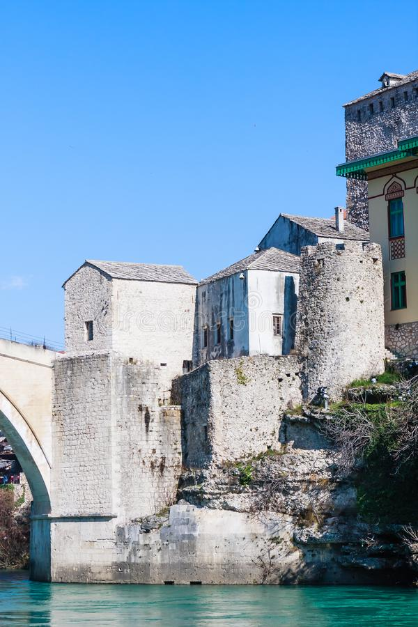 Beautiful view on Mostar city with old bridge and ancient buildings on Neretva river royalty free stock photography