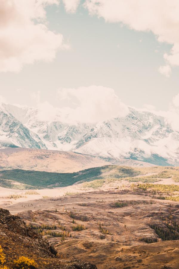 Beautiful view of the mountain range with snow-capped peaks. stock image