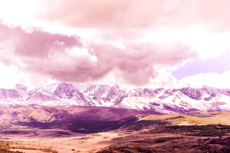Beautiful view of the mountain range under the pink clouds stock photo
