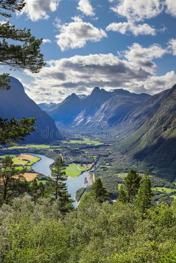 Beautiful view of the mountain valley and winding river. Aerial view of the bright green river in the mountain valley of Andalsnes Norway royalty free stock photos