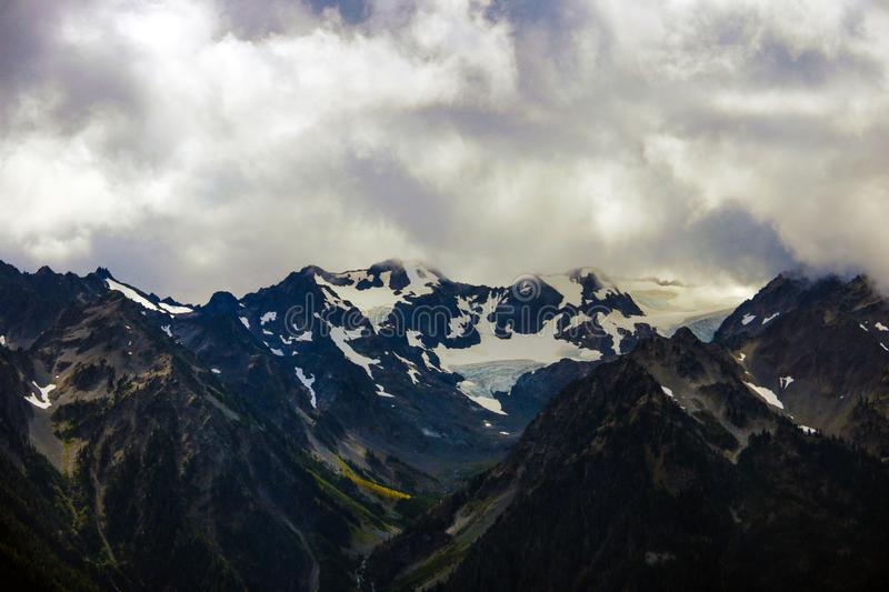 Beautiful view of the mountains surrounded by clouds stock images