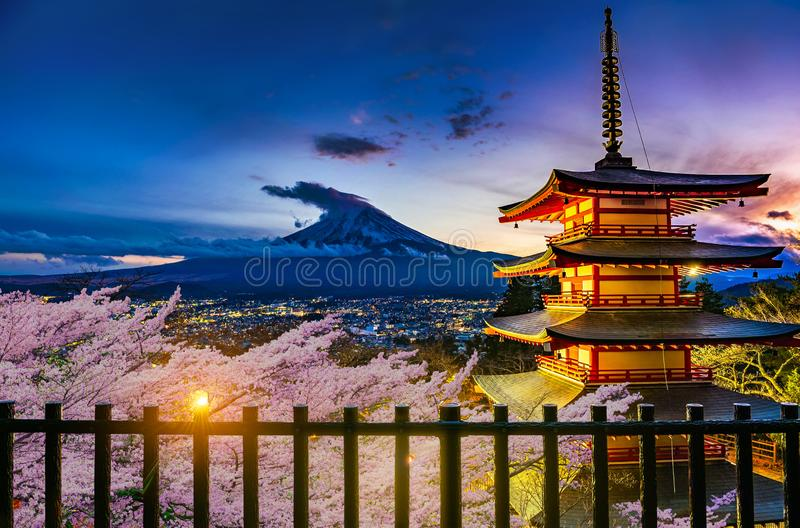 Beautiful view of Mt. Fuji and Chureito pagoda with cherry blossoms at sunset, japan stock photos
