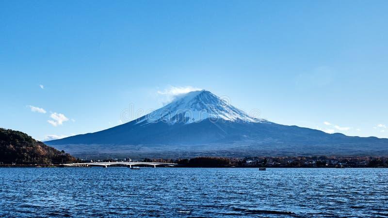 Beautiful view Mt.Fuji with snow capped, blue sky and the bridge at Kawaguchiko lake, Japan. stock photo