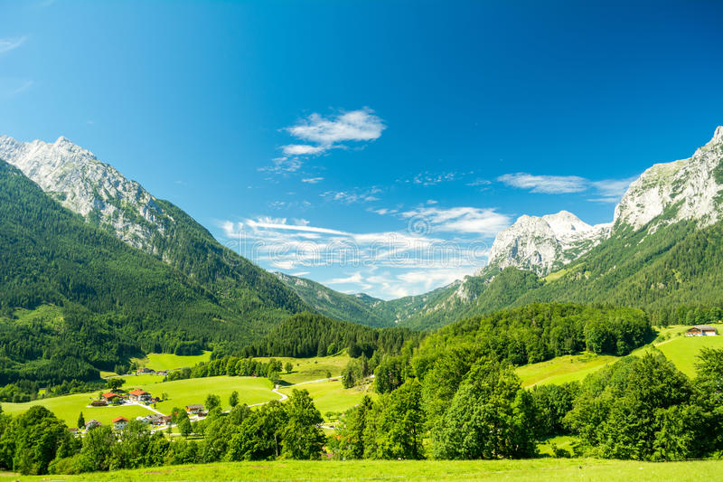 Beautiful view of nature and mountains near Konigssee lake, Bavaria, Germany. Beautiful view of nature, mountains and blue sky with clouds near Konigssee lake royalty free stock images