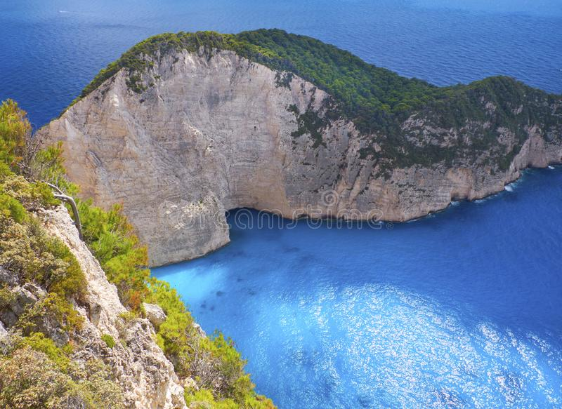 Beautiful view on Navagio rock of shipwreck beach sightseeing boat, blue water of Ionian Sea, blue caves fron Navagio view point. Sea touristic boat on water royalty free stock photo