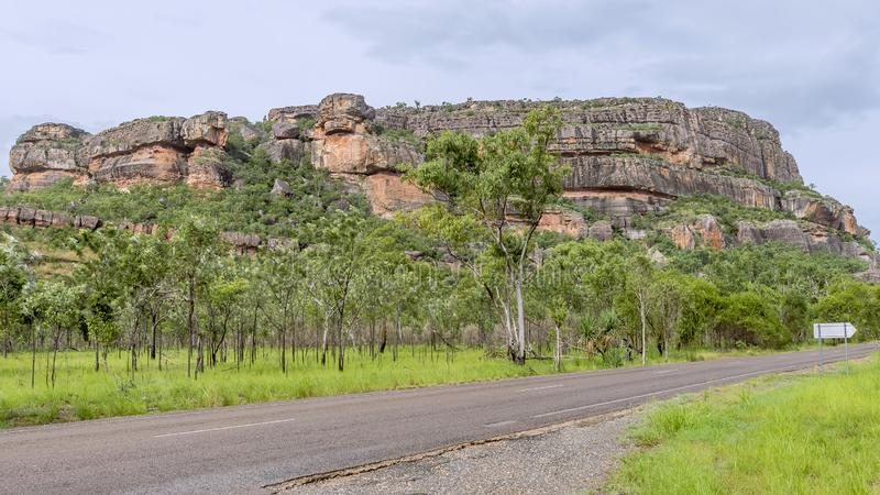 Beautiful view of Nourlangie Rock or Burrunggui in Kakadu Park on a sunny day with some clouds, Australia stock image