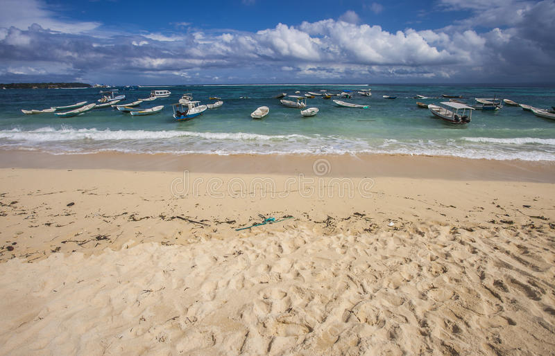 Beautiful View of Nusa Lembongan Beach, Bali, Indonesia. Between cloud, boats, sea, and the sand stock image