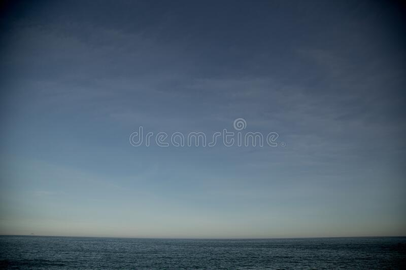 Beautiful view of an ocean under the blue sky in Rio de Janeiro, Brazil. A beautiful view of an ocean under the blue sky in Rio de Janeiro, Brazil royalty free stock photo