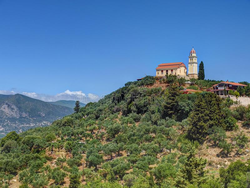 Beautiful view on orange roofing temple church on top of green hills mountains on Greece island Zakynth and blue sky. Greece lands royalty free stock image