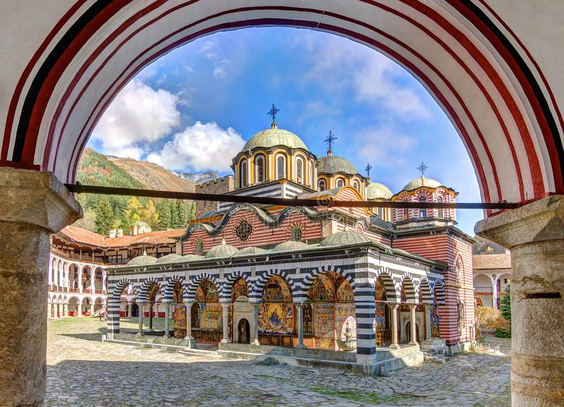 Rila monastery see through. Beautiful view of the Orthodox Rila Monastery, a famous tourist attraction and cultural heritage monument in the Rila Nature Park royalty free stock photo