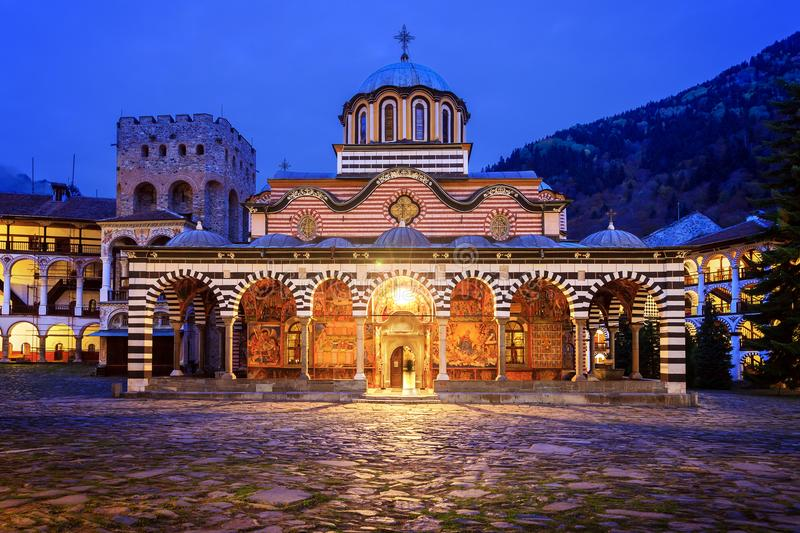 Rila church blue hour. Beautiful view of the Orthodox Rila Monastery, a famous tourist attraction and cultural heritage monument in the Rila Nature Park royalty free stock photo