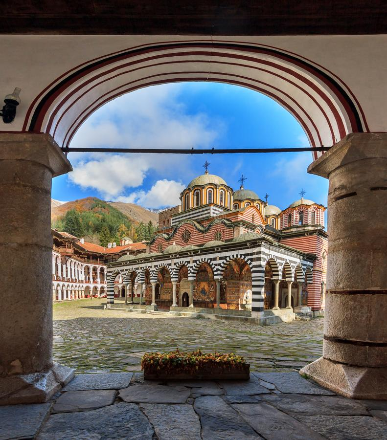 Rila monastery arched view. Beautiful view of the Orthodox Rila Monastery, a famous tourist attraction and cultural heritage monument in the Rila Nature Park royalty free stock photography