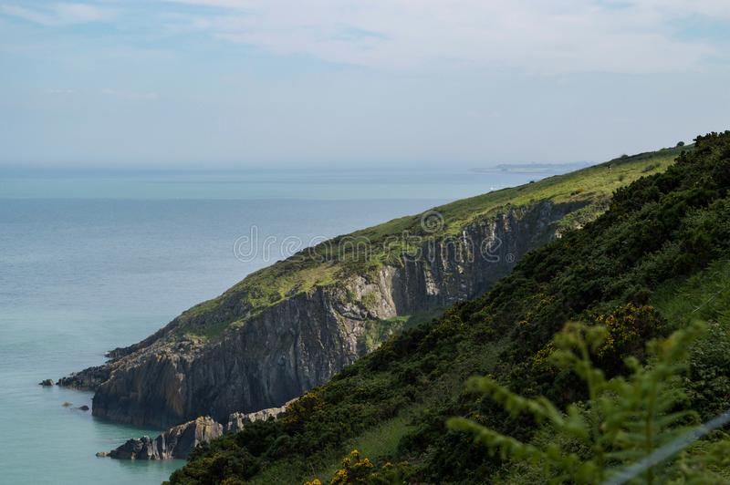 View from the cliffs of Co. Wicklow, Ireland over the Irish sea with Greystones in the distance royalty free stock image
