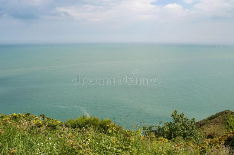 View from the cliffs of Co. Wicklow, Ireland over the Irish sea with Greystones in the distance stock photos