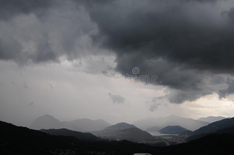 Beautiful view over the Lugano region during a storm in Switzerland royalty free stock photo