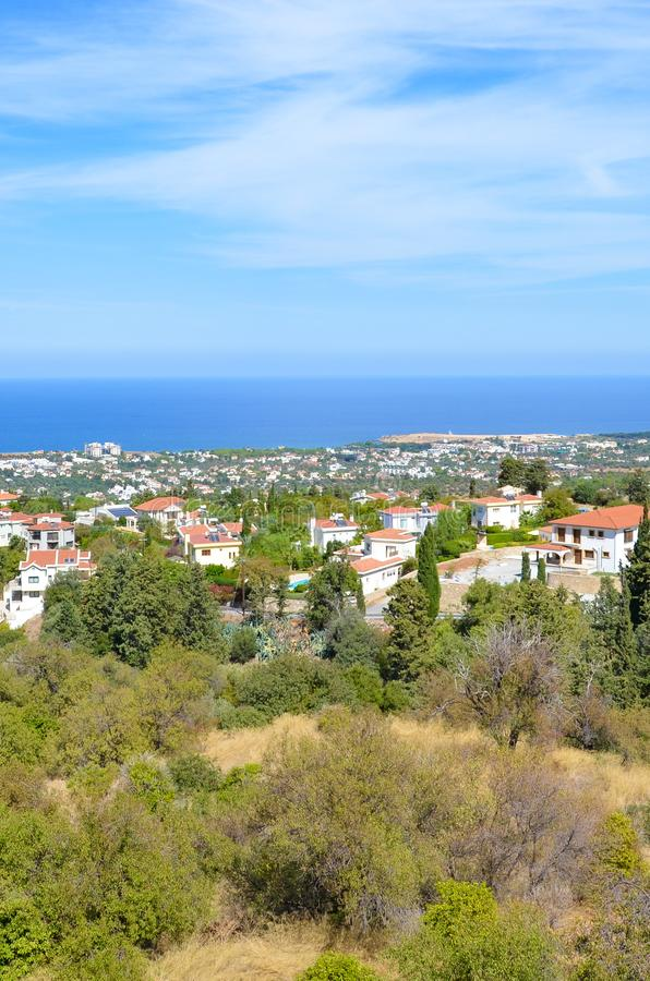Beautiful view over small city Bellapais in Kyrenia region, Northern Cyprus captured on a vertical picture. The view point is overlooking the Mediterranean sea royalty free stock photo