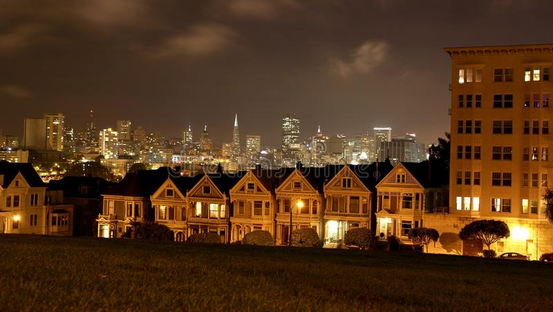 Beautiful view of Painted Ladies, colorful Victorian houses in a row in the evening in San Francisco / California, USA stock photo