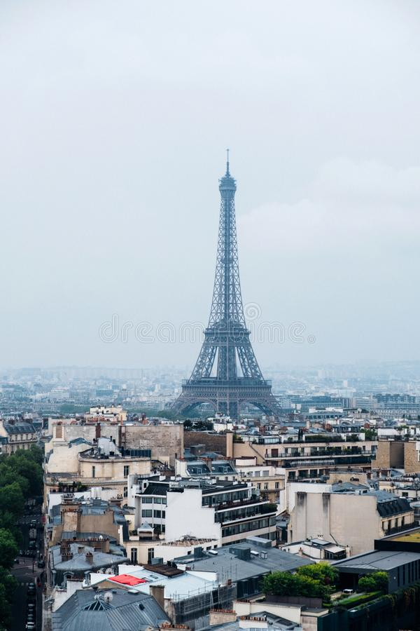 Beautiful view of Paris in a foggy day. Eiffel Tower and rooftops stock photo