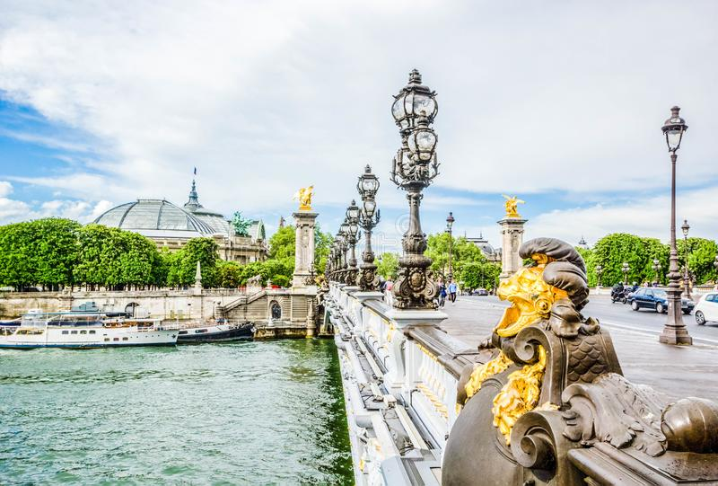 Beautiful view of Pont Alexandre III, bridge with golden sculptures and street lamps, Paris, France royalty free stock images