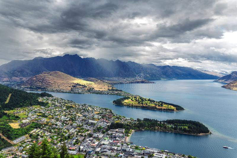 Beautiful view of Queenstown and lake Wakatipu from the hill on a cloudy weather. New Zealand stock image
