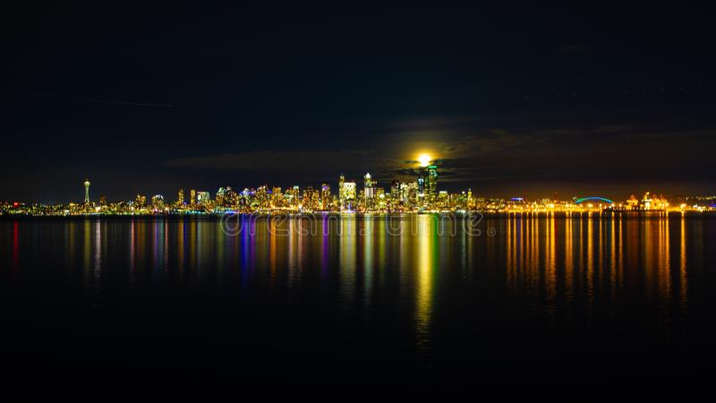 Beautiful view of the reflection lights on buildings in Seattle, USA in the sea at night. A beautiful view of the reflection lights on buildings in Seattle, USA stock image
