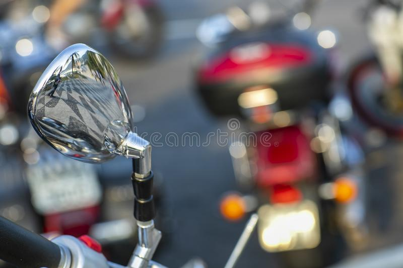 Beautiful view of the reflection in the mirror. Beautiful, original background. Motorcycle handlebar. stock image
